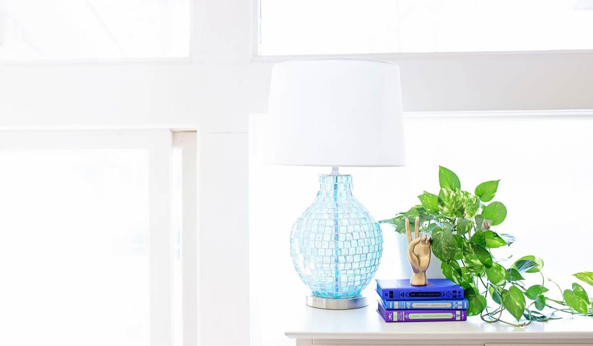 White Table Lamp on Sideboard Near Plant